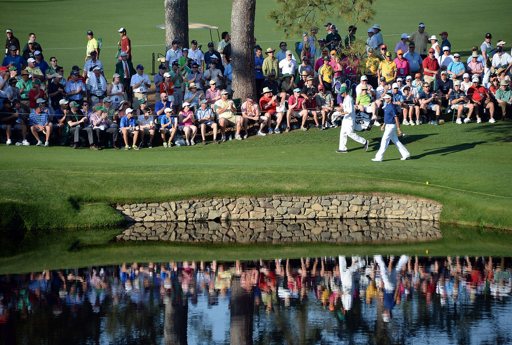 . Bubba Watson of the US makes his way to play a shot during the third round of the 78th Masters Golf Tournament at Augusta National Golf Club on April 12, 2014 in Augusta, Georgia.    JIM WATSON/AFP/Getty Images
