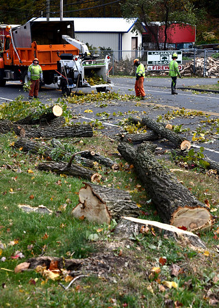 10/17/2019 Mike Orazzi | StaffrState of Connecticut workers clean up trees along Route 72 near Rockwell Park after heavy wind caused damage through out the area on Thursday.