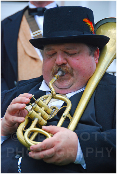 Playing a period instrument from the Civil War, a band member performs in Detroit, Michigan.