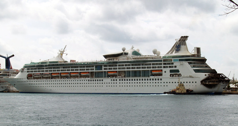 . The fire-damaged rear of Royal Caribbean\'s Grandeur of the Seas cruise ship is seen while docked in Freeport, Grand Bahama island, Monday, May 27, 2013. Royal Caribbean said the fire occurred early Monday while on route from Baltimore to the Bahamas on the mooring area of deck 3 and was quickly extinguished. All 2,224 guests and 796 crew were safe and accounted for. (AP Photo/The Freeport News, Jenneva Russell)