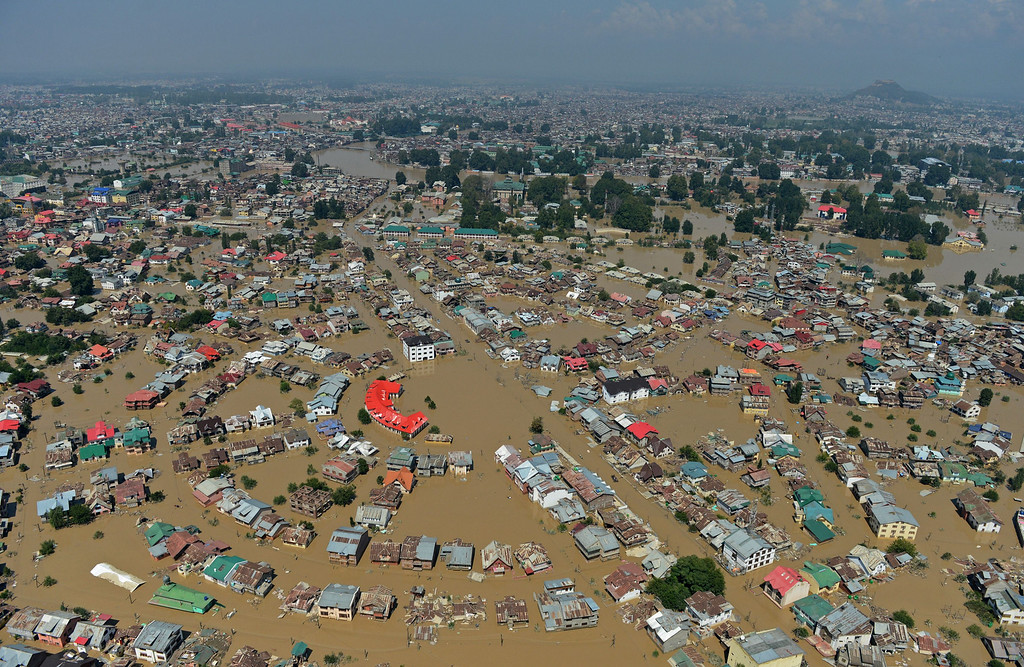 ". Kashmiri houseboats and houses submerged by floodwater are seen from an Indian Air Force helicopter during rescue and relief operations in Dal Lake in Srinagar on September 10, 2014. Anger mounted September 10 over the slow pace of rescue operations in Indian Kashmir as authorities said they were ""overwhelmed\"" by the scale of deadly flooding that has left hundreds of thousands of people stranded in India and Pakistan.  AFP PHOTO/Tauseef MUSTAFA/AFP/Getty Images"