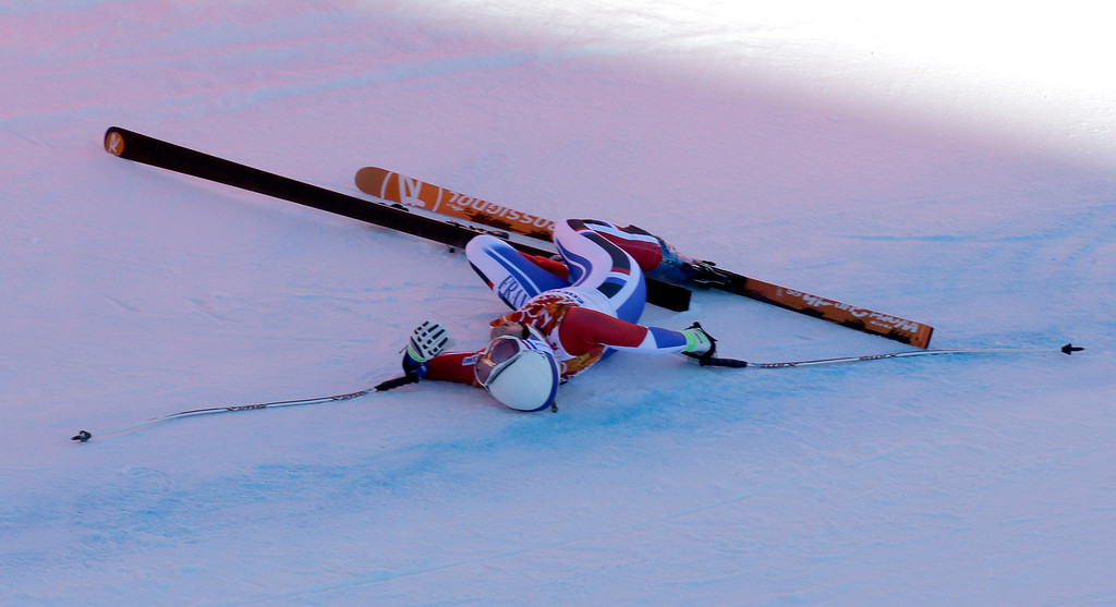 . France\'s Marie Marchand-Arvier lies on the course after crashing in the women\'s downhill at the Sochi 2014 Winter Olympics, Wednesday, Feb. 12, 2014, in Krasnaya Polyana, Russia. (AP Photo/Luca Bruno)