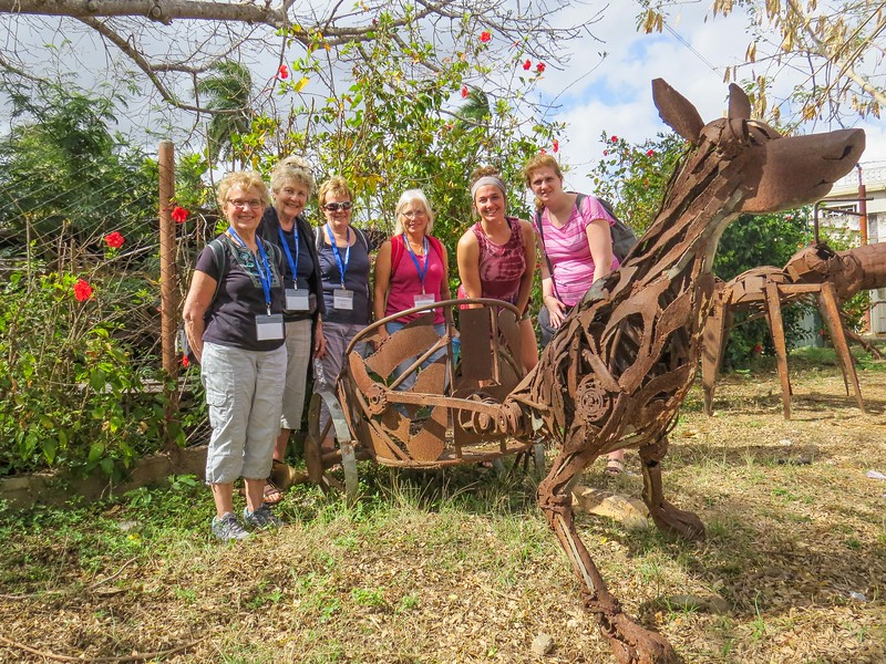 L-R: Judy, JoAnne, Nancy, Jennifer, Bree, and Elizabeth at one of the sculptures of repurposed trash metal.