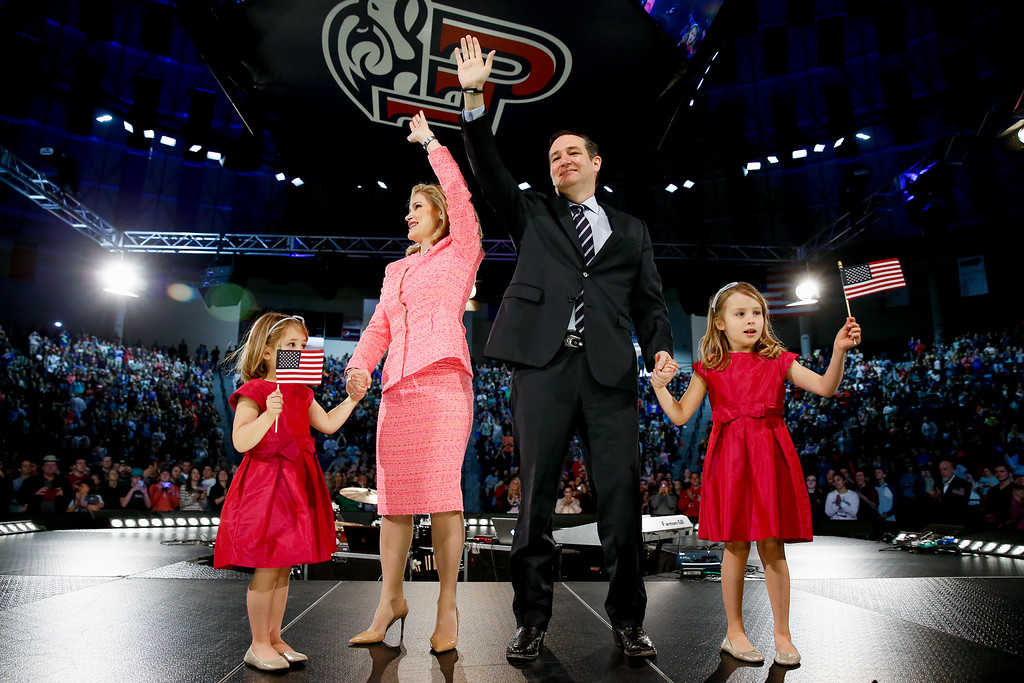 . Sen. Ted Cruz, R-Texas, his wife Heidi, and their two daughters Catherine, 4, left, and Caroline, 6, right, wave on stage after he announced his campaign for president, Monday, March 23, 2015, Liberty University, founded by the late Rev. Jerry Falwell, in Lynchburg, Va. Cruz, who announced his candidacy on twitter in the early morning hours, is the first major candidate in the 2016 race for president. (AP Photo/Andrew Harnik)