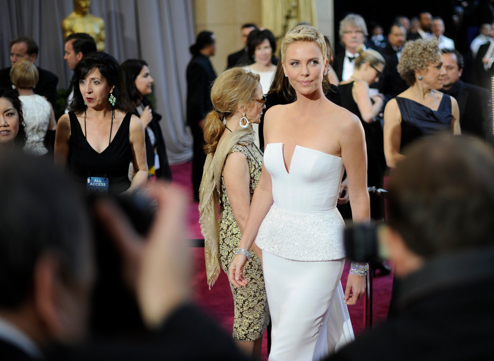Description of . Actress Charlize Theron arrives at the 85th Academy Awards at the Dolby Theatre in Los Angeles, California on Sunday Feb. 24, 2013 (Hans Gutknecht, staff photographer)