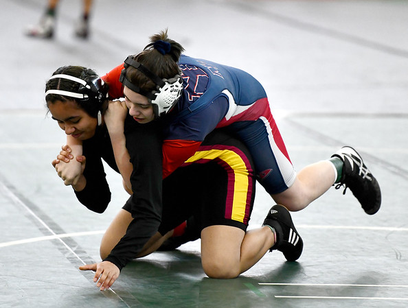 2/29/2020 Mike Orazzi | StaffrNew Britain's Monica Silva and New Fairfield's Ashley Wood during the CIAC 2020 State Open Wrestling Tournament at the Floyd Little Athletic Center in New Haven.rrr