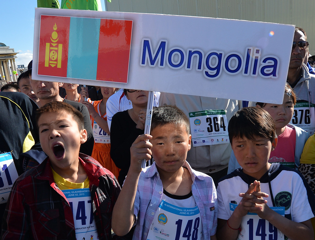 ". Young runners hold a banner before the start of the 4th International Mongolian marathon in Ulan Bator, Mongolia on June 2, 2013.  The race was won by Mongolian Olympic runner Bat-Ochiryn ""Ziggy\"" Ser-Od and is held to promote World Environment Day which falls on June 5th.      MARK RALSTON/AFP/Getty Images"