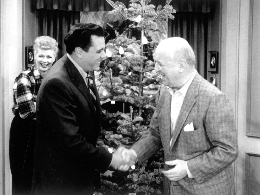 ". Lucy (Lucille Ball) looks on, as Ricky (Desi Arnaz) and Fred (William Frawley) share a holiday greeting in the ""I Love Lucy Christmas Special.\""   Los Angeles Daily News file photo"