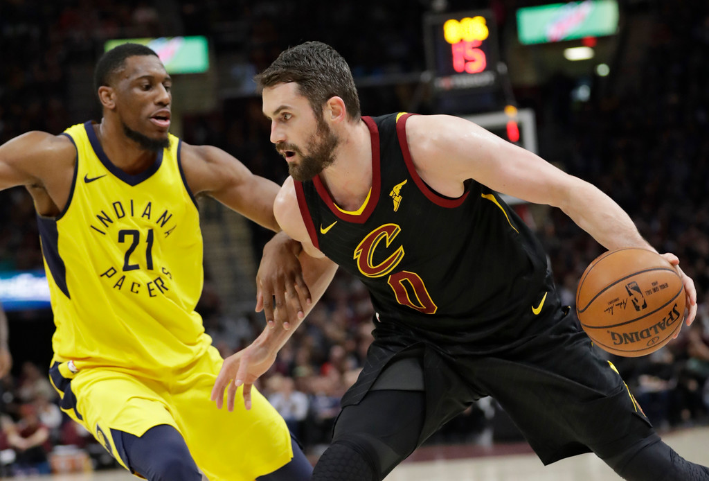 . Cleveland Cavaliers\' Kevin Love (0) drives past Indiana Pacers\' Thaddeus Young (21) in the first half of Game 5 of an NBA basketball first-round playoff series, Wednesday, April 25, 2018, in Cleveland. The Cavaliers won 98-95. (AP Photo/Tony Dejak)