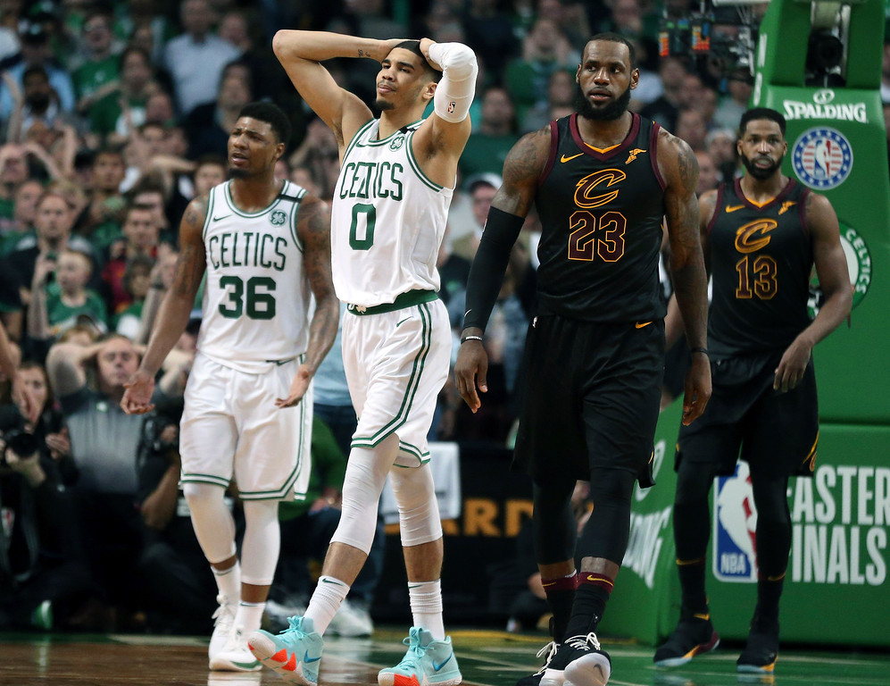 . Boston Celtics guard Marcus Smart (36) and forward Jayson Tatum (0) react in front of Cleveland Cavaliers forward LeBron James during the second half in Game 7 of the NBA basketball Eastern Conference finals, Sunday, May 27, 2018, in Boston. (AP Photo/Elise Amendola)