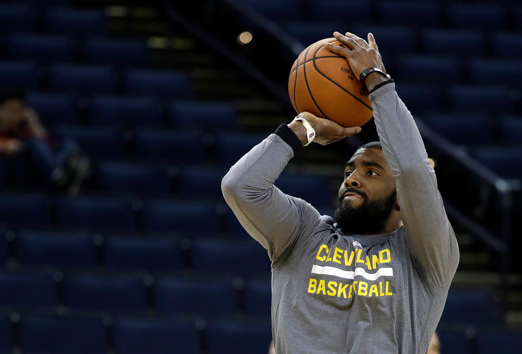 . Cleveland Cavaliers\' Kyrie Irving shoots during an NBA basketball practice, Wednesday, May 31, 2017, in Oakland, Calif. The Cavaliers face the Golden State Warriors in Game 1 of the NBA Finals on Thursday in Oakland. (AP Photo/Marcio Jose Sanchez)