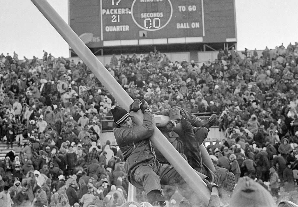 . Fans climb on the goal post at Lanbeau Field in Green Bay, Dec. 31, 1967, after the Packers beat the Dallas Cowboys for the NFL Championship, 21-17. (AP Photo)