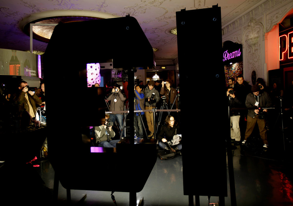 ". Members of the media take pictures and video as the number ""13\"" to be used during the Times Square New Year\'s Eve celebration is lit in New York, Wednesday, Dec. 19, 2012.  (AP Photo/Seth Wenig)"