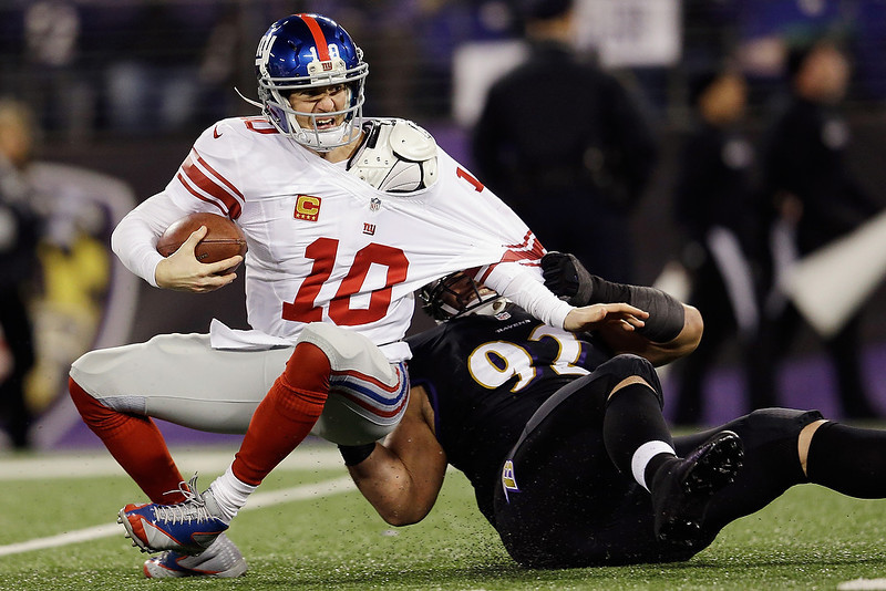 . Defensive end Haloti Ngata #92 of the Baltimore Ravens sacks quarterback Eli Manning #10 of the New York Giants during the second quarter at M&T Bank Stadium on December 23, 2012 in Baltimore, Maryland.  (Photo by Rob Carr/Getty Images)
