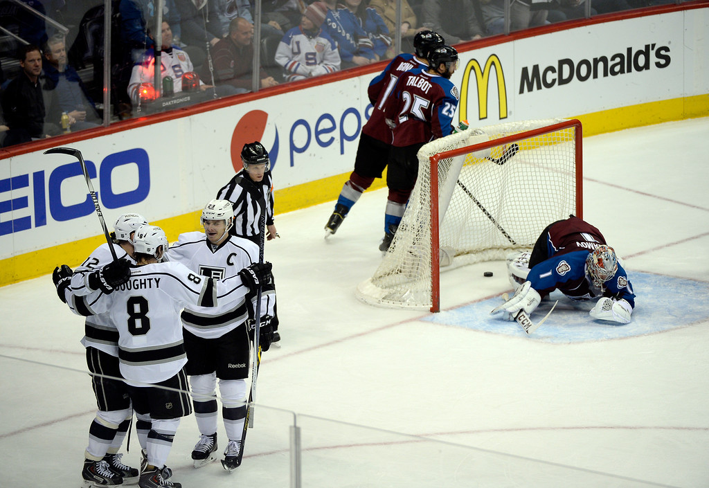 . DENVER, CO - FEBRUARY 18: Colorado Avalanche goalie Semyon Varlamov (1) lays on the ice dejected after a goal by Los Angeles Kings right wing Dustin Brown (23) as he celebrates with Los Angeles Kings defenseman Drew Doughty (8) and Los Angeles Kings right wing Marian Gaborik (12) during eh second period February 18, 2015 at Pepsi Center. (Photo By John Leyba/The Denver Post)