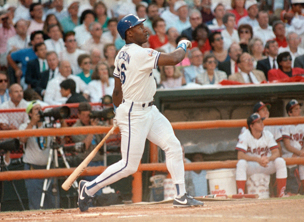 . FILE - This July 11, 1989, file photo shows Kansas City Royals\'  Bo Jackson watching the flight of his first-inning home run during the All-Star Game, in Anaheim, Calif. Jackson was an All-Star major leaguer and a Pro Bowler in the NFL. (AP Photo/Leonard Ignelzi, File)