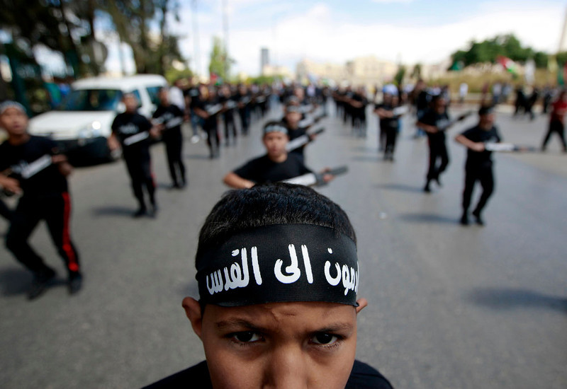 ". A Palestinian boy wears a bandana which in Arabic that reads, ""Coming to Jerusalem,\"" during a rally to mark the Nakba Day in the West Bank town of Ramallah, Wednesday, May 15, 2013., Tuesday, May 14, 2013. Palestinians annually mark the \""nakba,\"" or \""catastrophe\"" ó the term they use to describe their defeat and displacement in the war that followed Israel\'s founding in 1948. (AP Photo/Majdi Mohammed)"