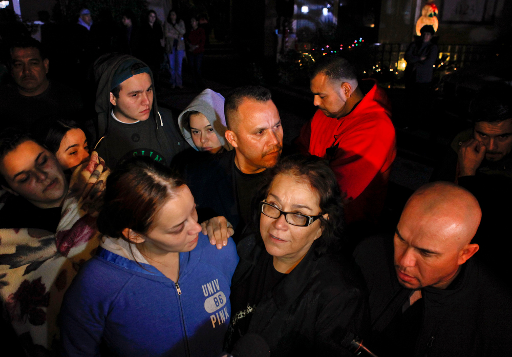 Description of . Rosie Rivera, sister of singer Jenni Rivera, hugs their mother Rosa Rivera, as Pastor Pedro Rivera Jr., rear, and Gustavo Rivera, right, watch during a news conference outside the home of Rivera\'s father in Lakewood, Calif., on Sunday, Dec. 9, 2012. Authorities have not confirmed her death, but Riveraís relatives in the U.S. say they have few doubts that she was on the Learjet 25 that disintegrated on impact Sunday in rugged territory in Nuevo Leon state in northern Mexico. (AP Photo/Patrick T. Fallon)