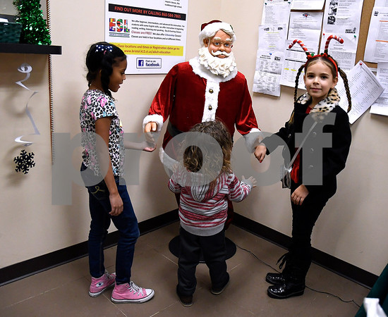 12/15/2017 Mike Orazzi | Staff Kaylee Ambert,8, Soliyi Green and Bella Nuzzo during a Christmas party Friday afternoon in Bristol at the Human Resources Agency of Bristol.
