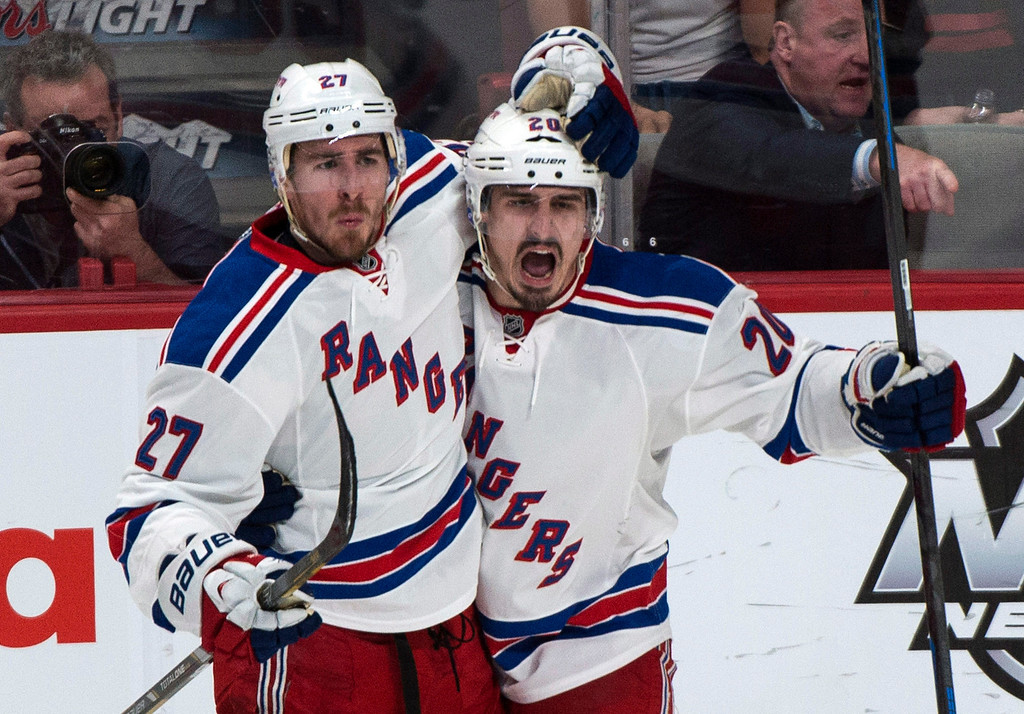 . New York Rangers\' Chris Kreider, right, celebrates his goal against the Montreal Canadiens with teammate Ryan McDonagh during the second period of Game 5 of the NHL hockey Stanley Cup playoffs Eastern Conference finals, Tuesday, May 27, 2014, in Montreal. (AP Photo/The Canadian Press, Paul Chiasson)
