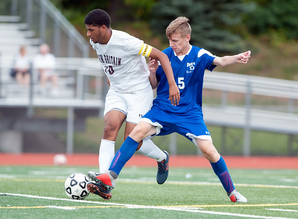 09/17/18 Wesley Bunnell | Staff Bristol Eastern soccer defeated New Britain 2-0 on Monday afternoon at Bristol Eastern High School. New Britain's Gabriel Navarro (10) and Bristol Eastern's Adam Borry (5).