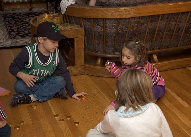 The kids play with a dreidel   (Nov 26, 2004, 04:11pm)