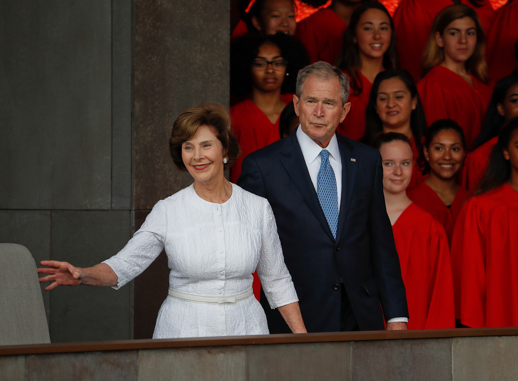 . In this photo taken Sept. 24, 2016, former President George W. Bush and former first lady Laura Bush are seen in Washington. Falling in line with tradition, Bill and Hillary Clinton plan to attend Donald Trump\'s inauguration. It�s a decision that will put Hillary Clinton on the inaugural platform as her bitter rival from the 2016 campaign assumes the office she long sought. The Clintons announced their decision to attend the Jan. 20 inauguration shortly after former President George W. Bush\'s office said Tuesday he would attend along with former first lady Laura Bush. (AP Photo/Pablo Martinez Monsivais, File)