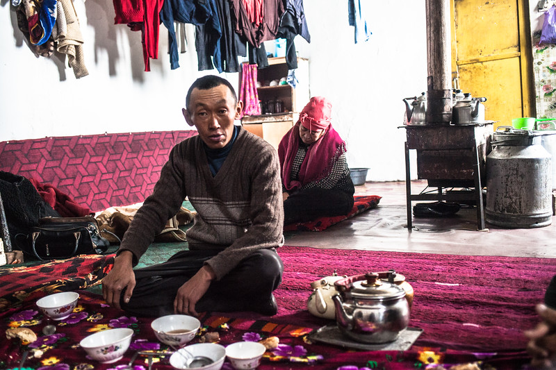 Breakfast for some, nap for others, between Tajikistan and Kirgyzstan
