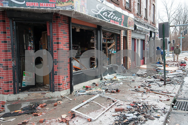 02/09/18 Wesley Bunnell   Staff Fire early Friday heavily damaged the recently condemned 408 Arch St and businesses still operating in the building.