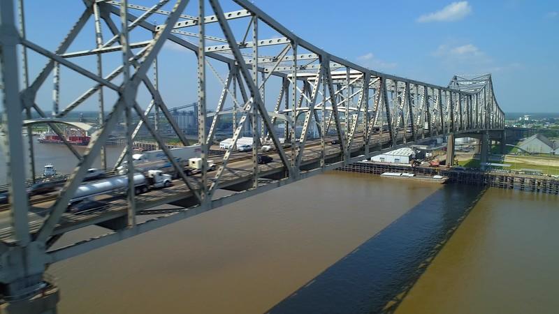 Aerial flyover metal industrial bridge over water