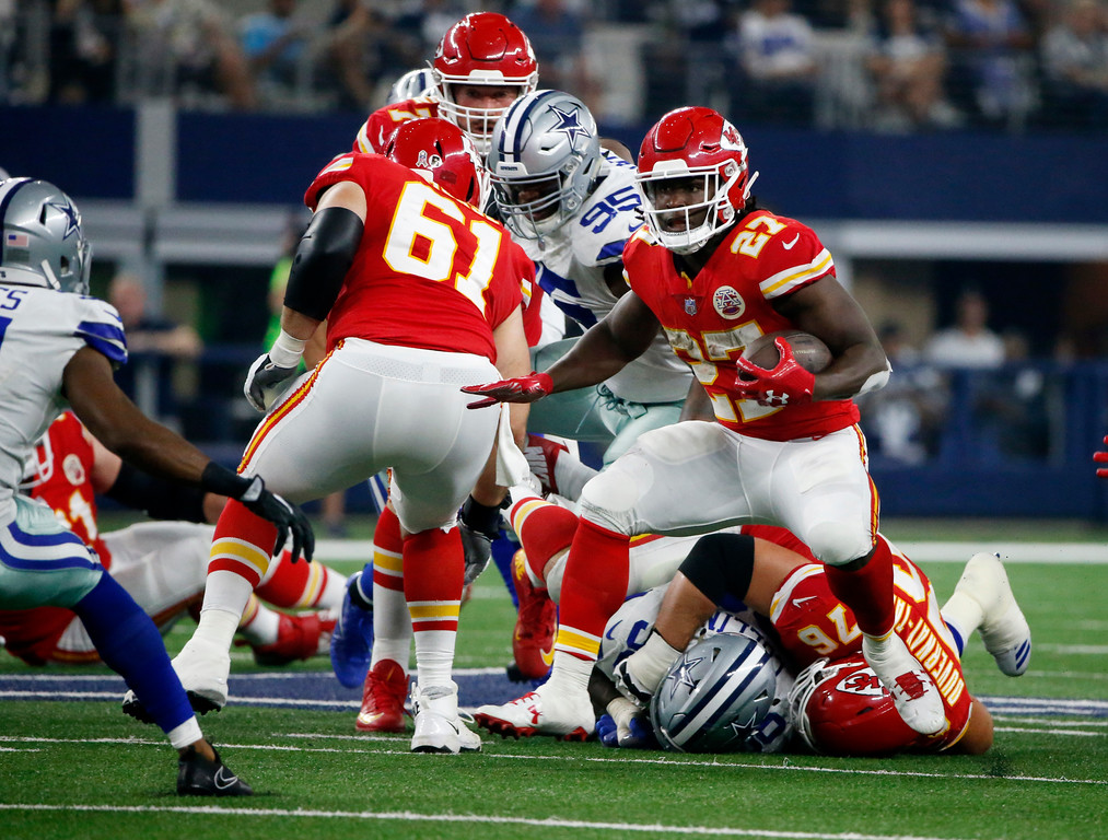 . Kansas City Chiefs\' Kareem Hunt (27) looks for running room in the second half of an NFL football game against the Dallas Cowboys on Sunday, Nov. 5, 2017, in Arlington, Texas. (AP Photo/Michael Ainsworth)