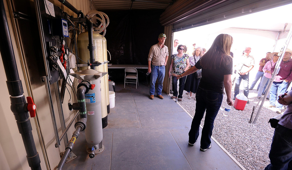 . Director of  Chromium Projects Sheryl Bilbrey of Pacific Gas and Electric Company speaks to a tour group about a Whole House Water system at an agriculture unit in Hinkley June 13, 2012. GABRIEL LUIS ACOSTA/STAFF PHOTOGRAPHER.