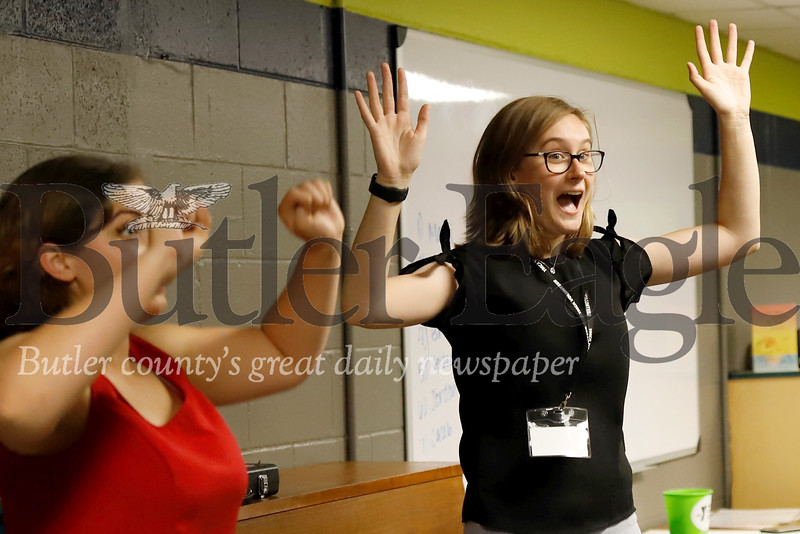 Slippery Rock University music therapy students Elizabeth Ambrose (left) and Rachael Kovaly lead a dance party at a recent Reach and Rise session at the Butler YMCA. Seb Foltz/Butler Eagle