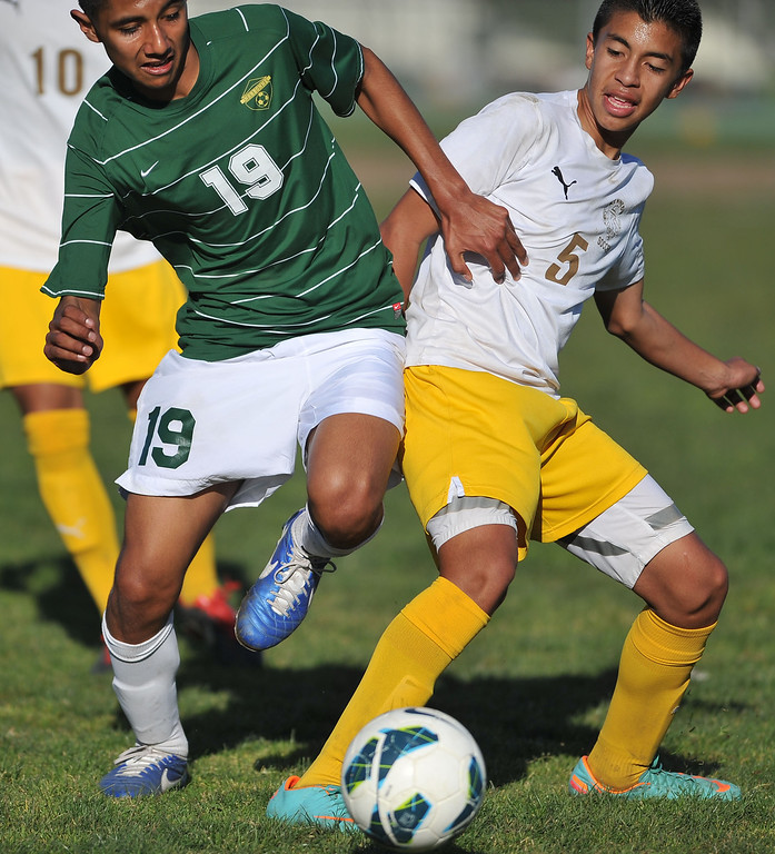 . 2/13/13 - L-R Andrew Perez of Narbonne  High School battles for the ball against  Marco Ramirez of Kennedy during the L.A. City Section Division I playoffs. Narbonne won 1-0. Photo by Brittany Murray / Staff Photographer