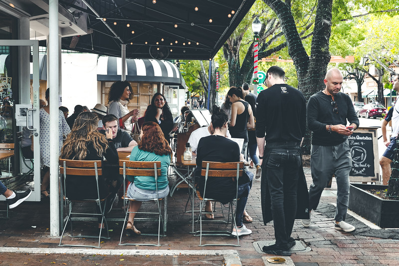 Sidewalk seating in a restaurant in the Grove