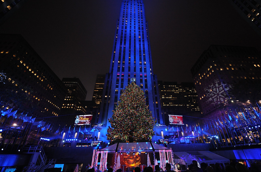 . People watch as the Rockefeller Center Christmas tree is lit during the 83rd Annual Rockefeller Center Christmas Tree Lighting Ceremony on Wednesday, Dec. 2, 2015, in New York. The Norway Spruce tree stands at about 78 feet tall and is lit with multi-colored LED lights. (Photo by Brad Barket/Invision/AP)