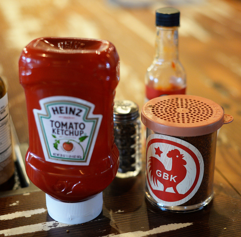 . The spices and ketchup on the counter at the GoodBird Kitchen is a new restaurant in Longmont, CO on  Thursday, February 25, 2016. It is a supreme casual comfort food kinda place and is located at 1258 S. Hover Road in Longmont.  (Photo by Cyrus McCrimmon/ The Denver Post)