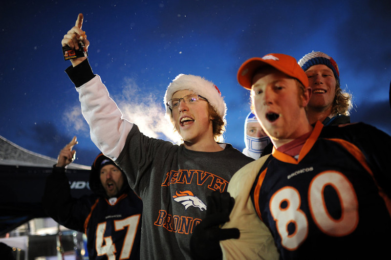 . Denver Broncos fans Keith Schlichting, front left, and his brother Zach (80) are in the United in Orange Pep Rally at Sports Authority Field at Mile High in Denver on Friday. Denver. CO, January 11, 2013.  Hyoung Chang, The Denver Post