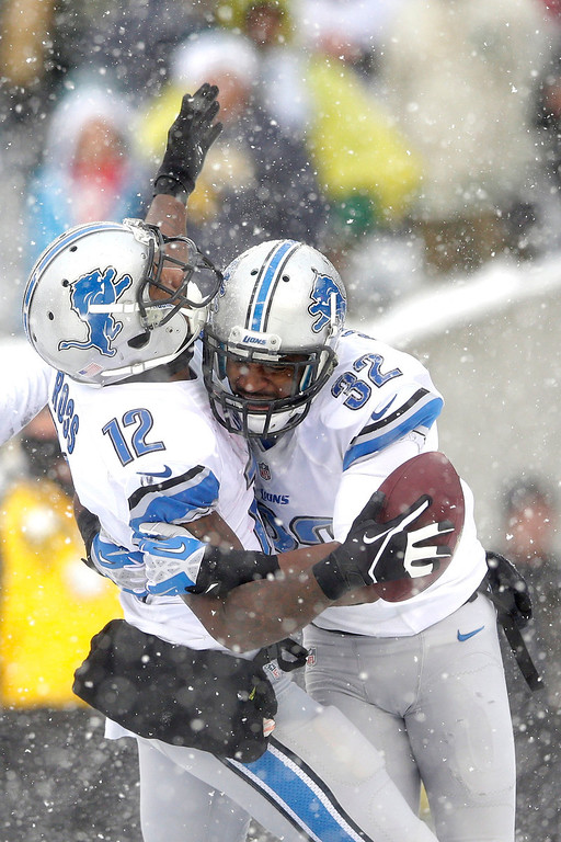 . Detroit Lions\' Jeremy Ross, left, celebrates with Don Carey after scoring a touchdown during the second half of an NFL football game against the Philadelphia Eagles, Sunday, Dec. 8, 2013, in Philadelphia. (AP Photo/Michael Perez)