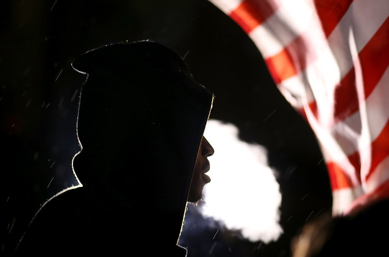 . A demonstrator protesting the shooting death of 18-year-old Michael Brown blows cigar smoke on November 22, 2014 in Ferguson, Missouri. Tensions in Ferguson remain high as a grand jury is expected to decide this month if Ferguson police officer Darren Wilson should be charged in the shooting death of Michael Brown.  (Photo by Justin Sullivan/Getty Images)