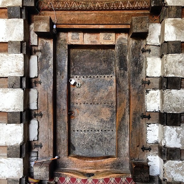 Favorite ancient doorway candidate #32. This one literally buried in a cave, at the 12th century Yemrehanna Kristos church in the northern Ethiopian hills. via Instagram http://ift.tt/1jcHCy9