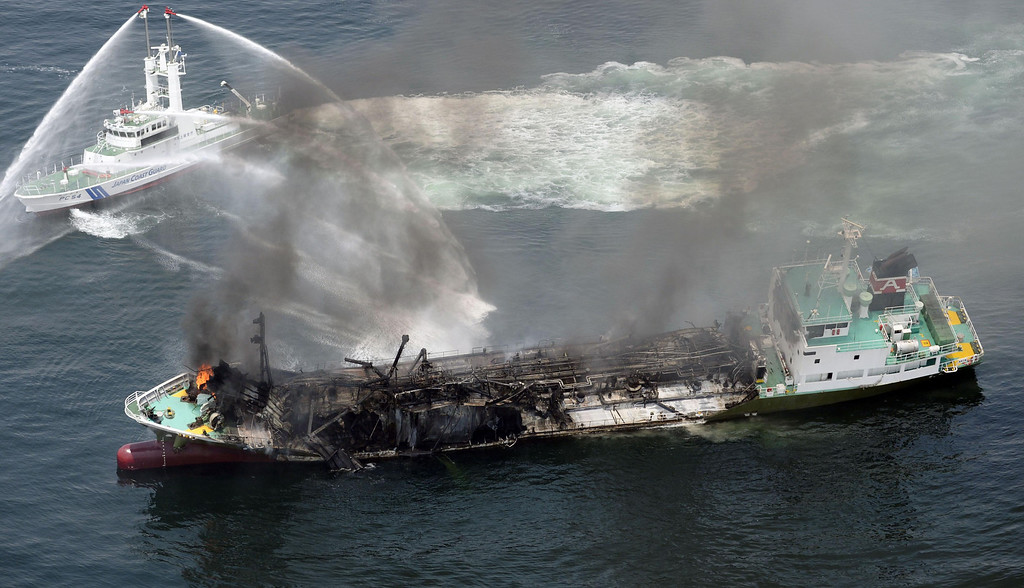 . Black smoke rises from Shoko Maru, a 998-ton tanker, after it exploded in waters off Himeji port, western Japan, Thursday morning, May 29, 2014. Japan Coast Guard said the Japanese oil tanker exploded Thursday, leaving one of the eight people aboard missing. (AP Photo/Kyodo News)