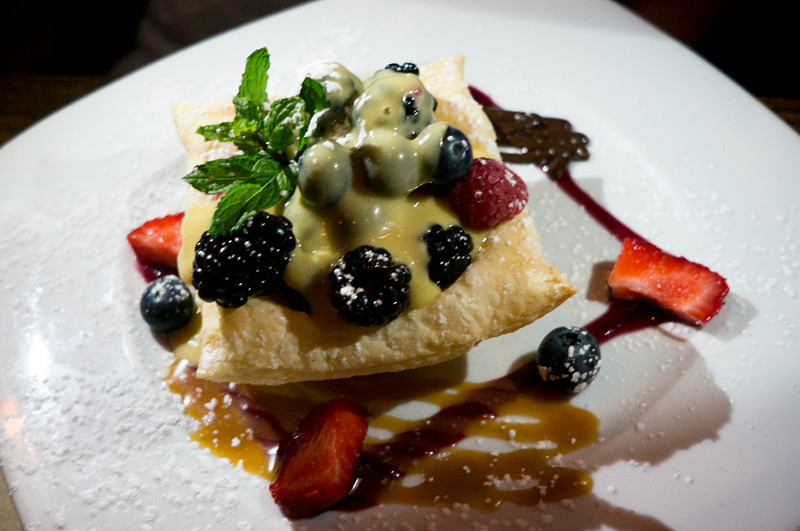 Mixed berries with warm zabaion in a puff basket at Da Andrea.