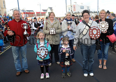 Bessbrook Crimson Arrow Pipe Band supporters pictured as they carry the band's trophies through the packed streets of Portrush following the North West Pipe Band Championships on Saturday 23rd August.