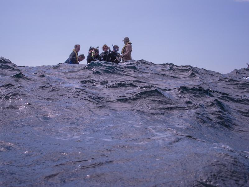 Group and waves at Kicker Rock
