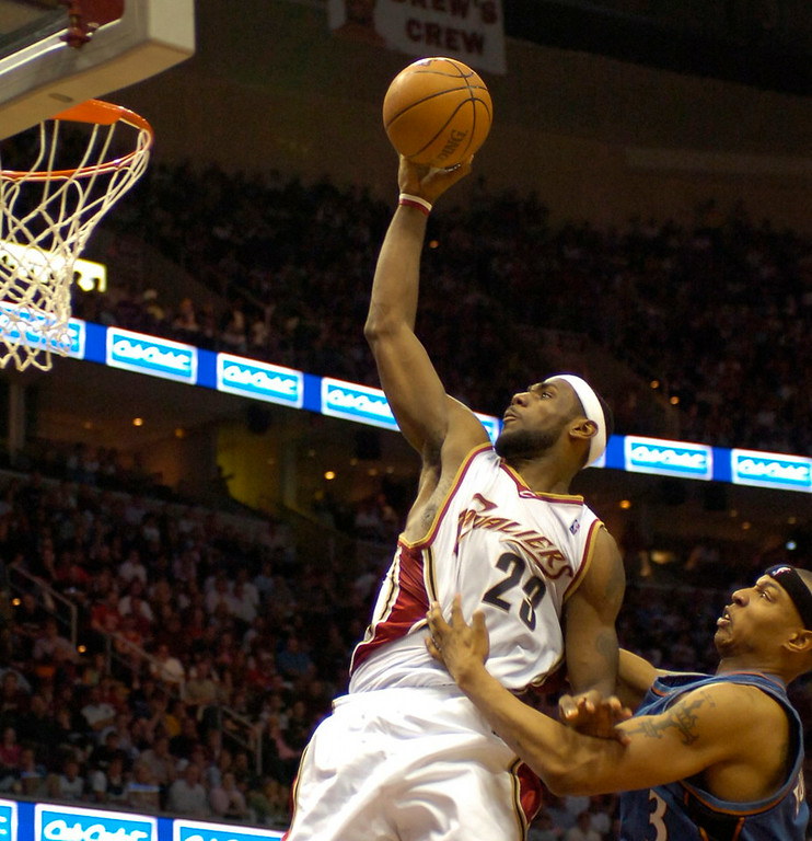 . PHOTO BY DAVID RICHARD LeBron James of Cleveland is fouled by Washington\'s Caron  Butler yesterday in the second half.