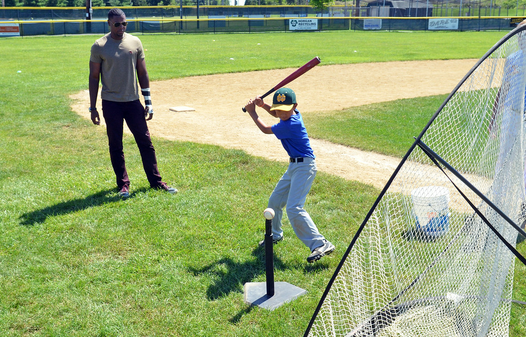 . Nine-year-old Connor Baker takes a swing under the watchful eye of Phillies outfielder John Mayberry Jr. at  Nor Gwyn baseball camp in Upper Gwynedd.    His visit was arranged by Sanctuary United Methodist Church pastor Jim Carver, who is friends with Phillies pastor Rich Sparling.   Mayberry talked about baseball,  his spirituality, and answered the youngters\' many questions.     Friday,  July 25, 2014.   Photo by Geoff Patton