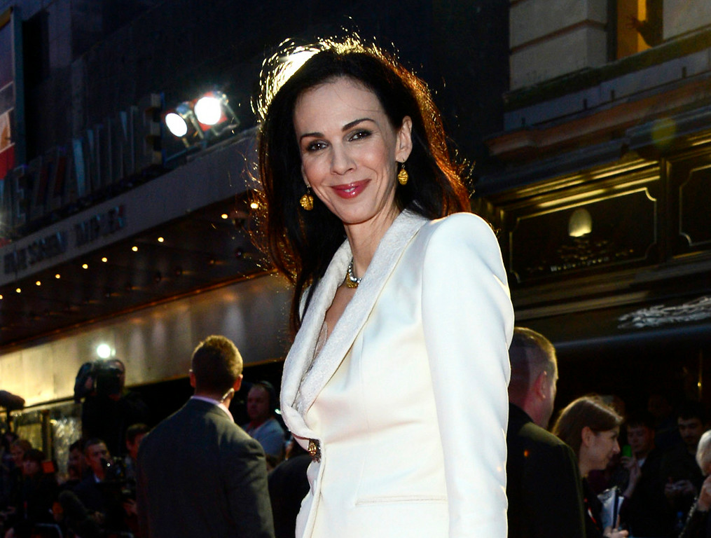 ". This Oct. 18, 2012 file photo shows L\'Wren Scott at the London Film Festival American Express Gala for ""The Rolling Stones - Crossfire Hurricane\"", in London. Scott, a fashion designer, was found dead Monday, March 17, 2014, in Manhattan of a possible suicide.  http://bit.ly/1p8x3uH  (Photo by Jon Furniss/Invision, File)"