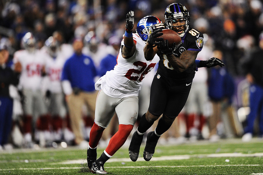 . Wide receiver Anquan Boldin #81 of the Baltimore Ravens makes a catch past safety Antrel Rolle #26 of the New York Giants in the third quarter at M&T Bank Stadium on December 23, 2012 in Baltimore, Maryland. The Baltimore Ravens won, 33-14.  (Photo by Patrick Smith/Getty Images)
