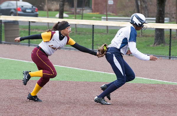 New Britain softball defeated Hartford Public at Chesley Park on a windy and rainy Monday afternoon. Josleen Rivera (1) tags the Hartford runner out as she chases her back to first. Wesley Bunnell | Staff